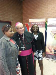 Archbishop Slattery posing for a photo with Zim community congregant